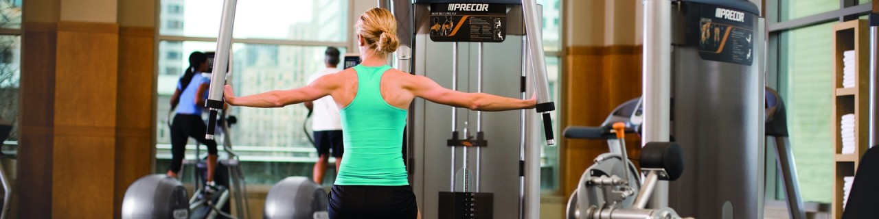 Hospitality_Female on Experience Strength S-Line Rear Delt with Cardio in background-1920x480